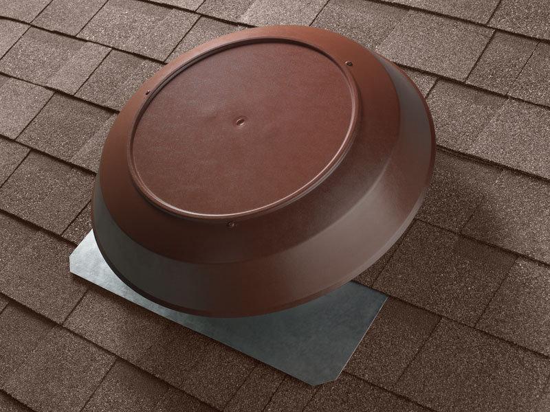 Brown attic fan on roof